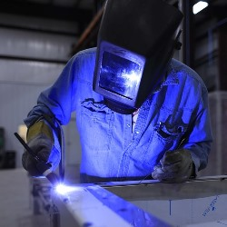 welder working in Ider AL shop